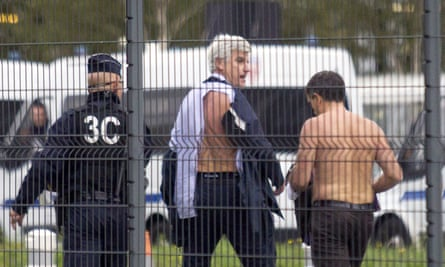 Two Air France directors flee after scuffles with workers at the airline's headquarters at Roissy/Charles de Gaulle airport.