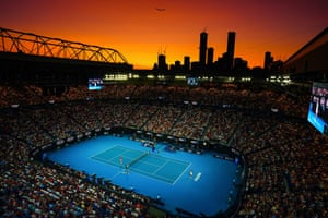 A view of the sun setting behind the Melbourne skyline from the Rod Laver Arena