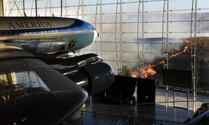 Ronald Reagan's Air Force One sits on display at the Reagan presidential library as fire burns in the hills in Simi Valley, California.