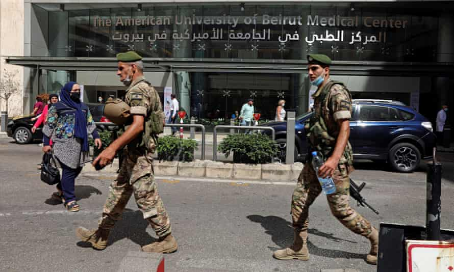 Lebanese soldiers outside the American University of Beirut Medical Centre, which let go hundreds of employees.