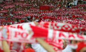Poland fans hold up their scarves during the quarter-final match against Portugal which finished 1-1 (aet)