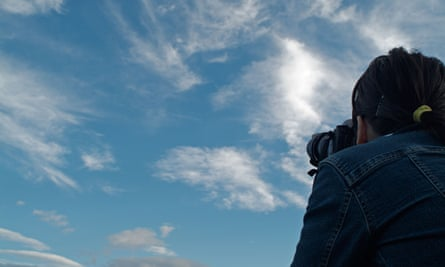 photographer taking picture sky
