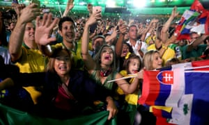 Fans from Brazil celebrate in the stands during the opening ceremony.