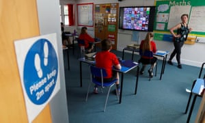 Children in an adapted classroom at Watlington primary school in Oxfordshire as some schools in England re-open as lockdown measures are eased.