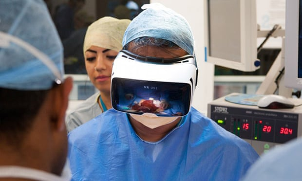 Dr Shafi Ahmed performs the operation which could be watched online by the public. Photograph: Medical Realities/PA. The Guardian.