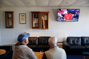 Two drinkers in the clubhouse watch an England T20 match against Pakistan while Lowerhouse take on Norden.