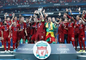 Jordan Henderson lifts the trophy Liverpool celebrate winning the UEFA Super Cup.