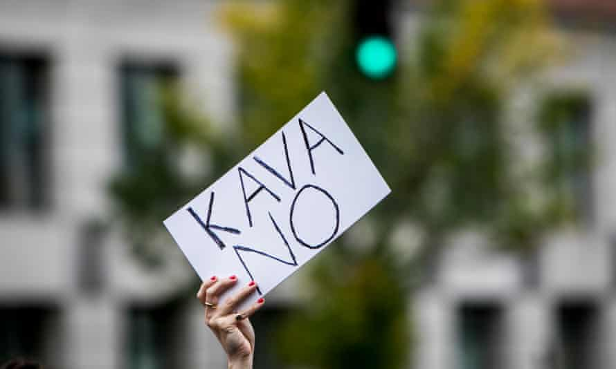 An activist holds up a sign rejecting the supreme court nominee Brett Kavanaugh. Hundreds of law professors have signed two letters urging the Senate to oppose Kavanaugh.