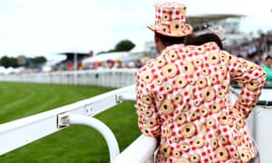 A racegoer was spotted wearing a Jammie Dodger-themed suit at Goodwood on Friday.