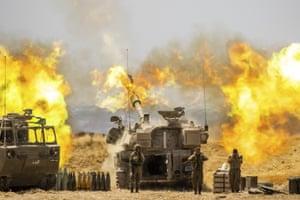 An Israeli artillery unit fires toward targets in Gaza