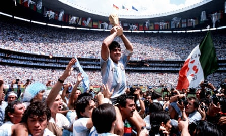 Diego Maradona holds the World Cup trophy in 1986.