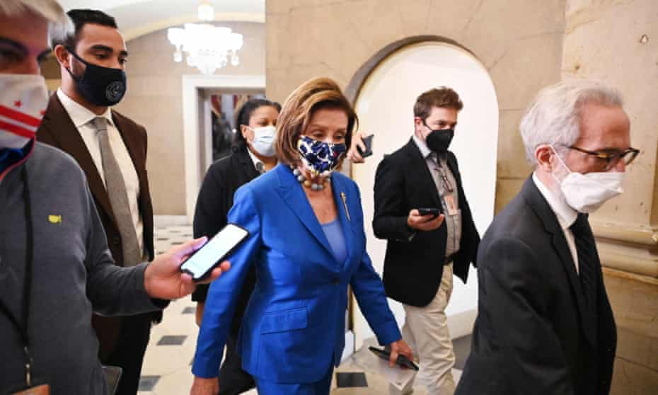 Nancy Pelosi, the House speaker, on the way to the chamber on Tuesday. Joe Biden is expected to sign the measure into law this week.