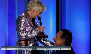 Richard E Grant accepts the Best Supporting Male award from Glenn Close.