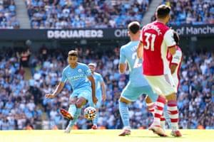 Rodrigo (centre) curls home Manchester City's fourth goal.