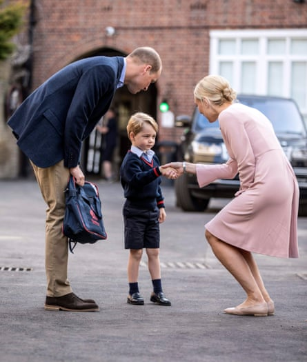 Prince William and Prince George meet Helen Haslem, head of the lower school, at Thomas's school in Battersea.