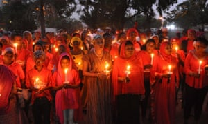 Nigerians holding candles during a vigil for last year's one year anniversary of the kidnapping of hundreds of Nigerian school girls in Chibok.