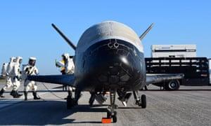 Technicians inspect the X-37B
