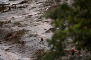 Rescue workers search for victims