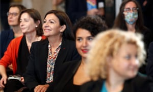 Anne Hidalgo, the mayor of Paris, centre left, with several female colleagues at a council meeting