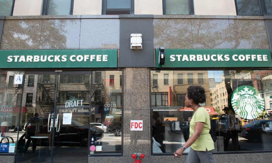 A woman walks past a a Starbucks closed for racial bias training in the New York district of Chelsea on Tuesday.