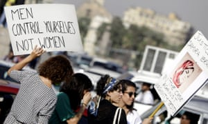 Women hold banners during a protest in the Egyptian capital Cairo against alleged sexual harassment by human rights lawyers