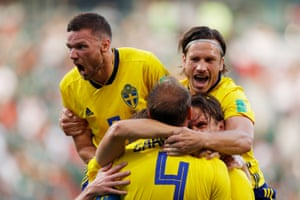 Sweden's Andreas Granqvist celebrates scoring their second goal with team-mates.