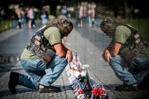 Rolling Thunder participant, David Borden, 67 of Dahlonega, Florida, USA, pauses to pay his repects to a fallen comrade at the Vietnam Veterans Memorial in Washington, DC