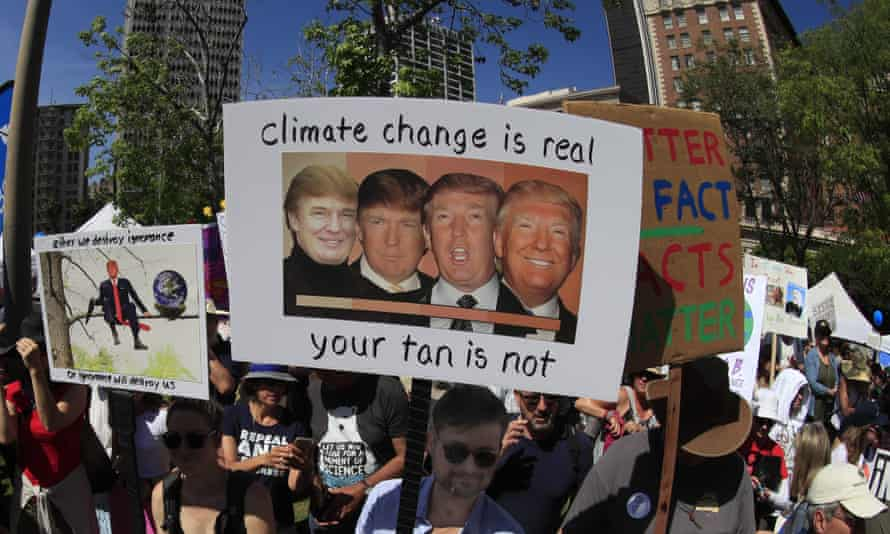 Climate protester with Trump sign