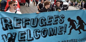 """Participants in a demonstration in Frankfurt hold a banner reading """"Refugees welcome."""""""