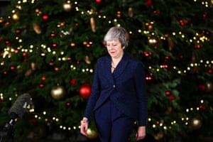 Britain's Prime Minister Theresa May prepares to speak outside 10 Downing Street after a confidence vote by Conservative Party Members of Parliament, in London, 12 December