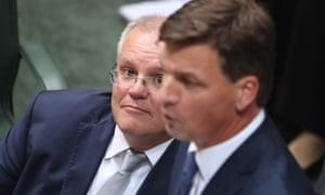 Scott Morrison watches Angus Taylor during question time
