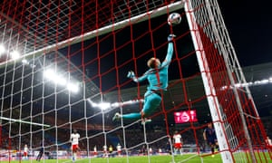 Leipzig's Peter Gulacsi dives to keep Bayern Munich at bay during a one-sided early title showdown in teh Bundesliga.