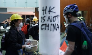 People walk inside the Legislative Council building, after protesters stormed the building on the anniversary of Hong Kong's handover to China