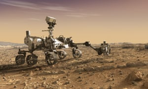 Rover on six wheels with probe out front on rocky surface.