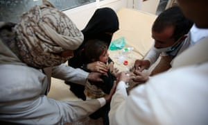A girl is treated for a suspected cholera infection in Sanaa, Yemen