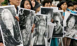 Japanese women hold portraits of former comfort women who were sex slaves for Japanese soldiers during the second world war, at a protest held in front of the Japanese parliament in 2007.