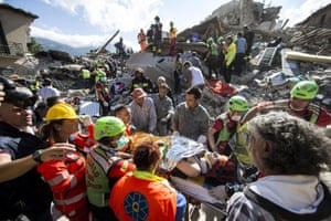 A woman is rescued from rubble in Amatrice, Italy