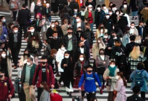 Tokyo, Japan Pedestrians wear protective masks in Shibuya after the city marked 570 new coronavirus infections, its highest record per day