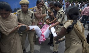 Police detain a protester in Hyderabad, India