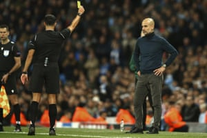 Manchester City's head coach Pep Guardiola is shown yellow card.
