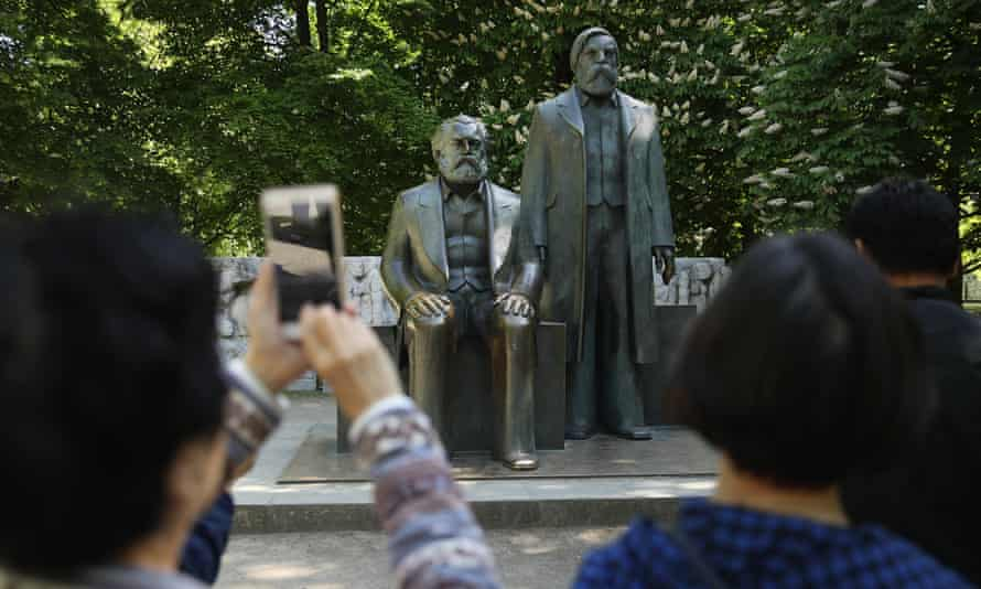 Visitors snap pics of statues of Marx (left) and Engels in a park in Berlin
