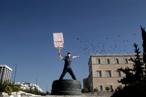 Anti-austerity protest in Athens<br>epaselect epa05021965 A protester shouts in front of the parliament during an anti-austerity rally, in central Athens, Greece 12 November 2015. The strike has been called by Greece's two largest umbrella trade union groups, the General Confederation of Employees of Greece (GSEE), representing the private sector, and the civil servants' union federation ADEDY - in protest against pension reforms, the prior actions demanded by Greece's creditors and changes in labour law. EPA/YANNIS KOLESIDIS