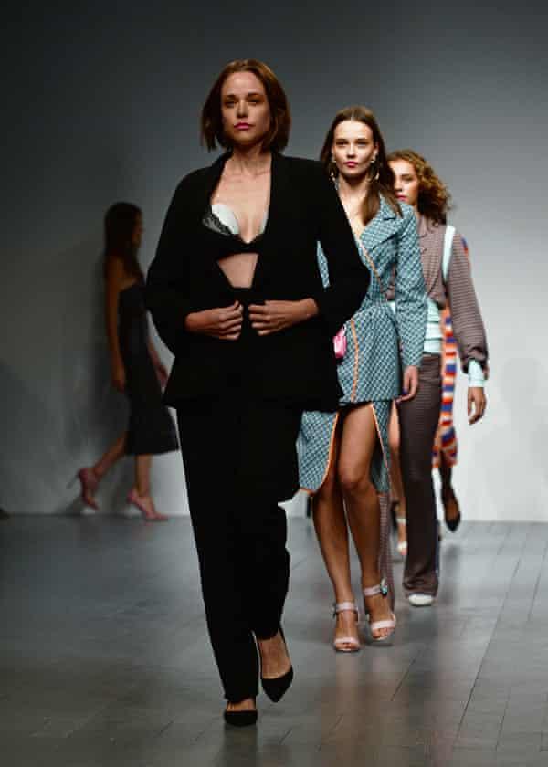 Valeria Garcia appearing on the catwalk wearing an Elvie breast pump