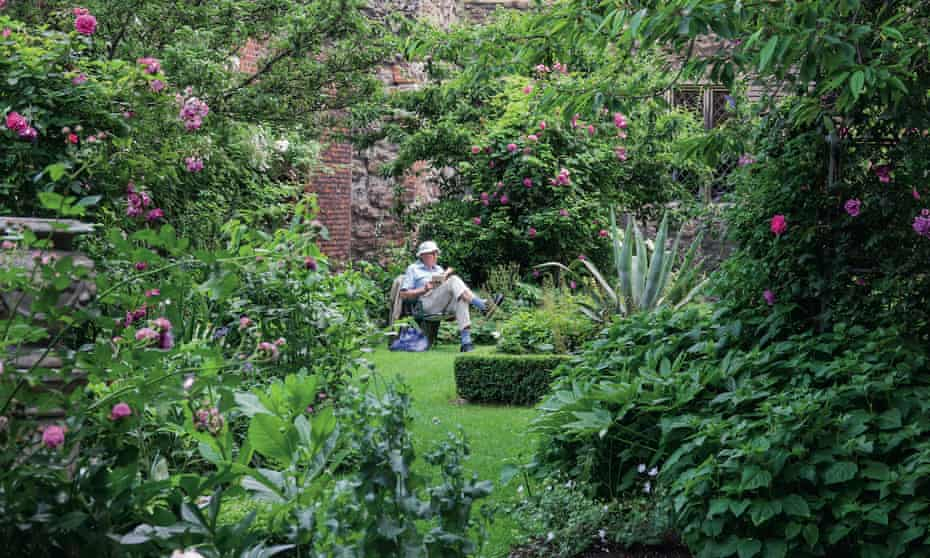 A 'brother' relaxes in the garden of the Charterhouse almshouse in the City of London