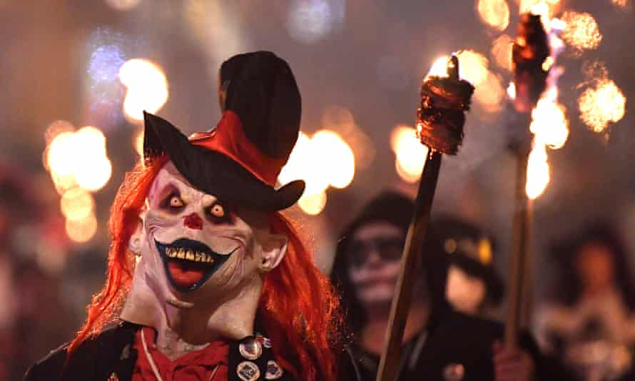 Participants parade through the town during the annual Bonfire Night festivities in Lewes