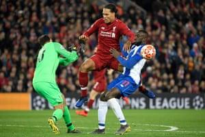 Porto's Malian striker Moussa Marega (R) vies for the ball with Liverpool's Dutch defender Virgil van Dijk (C) and Liverpool's Brazilian goalkeeper Alisson Becker
