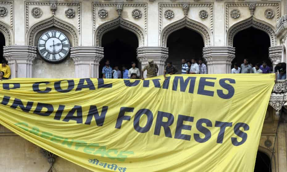 Police pull down a Greenpeace protest banner in Hyderabad in 2012.