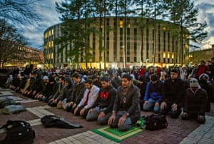People pray on the campus of NC State in Raleigh