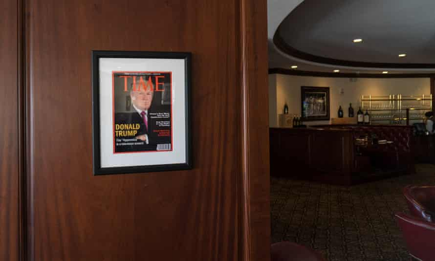 Framed portrait of President Donald Trump on the cover of a Time Magazine hanging from a column in the Champions Sports Bar & Grill at the Trump National Doral Miami.