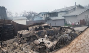 The remains of charred vehicles. The fires have forced the evacuation of more than 80,000 residents from the town.